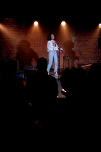 Black African American Young Female Comedian Performing Her Stand-up Monologue On A Stage Of A Small Venue