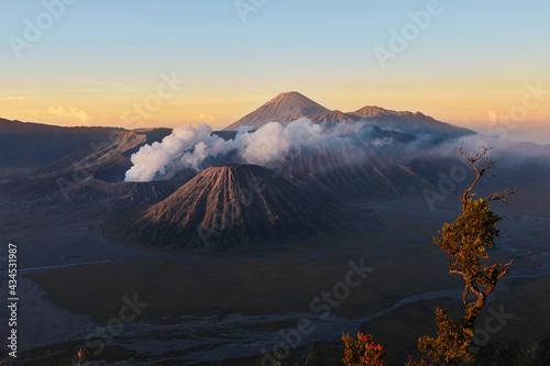 Active volcano in clouds of smoke with crater in depth Fotobehang