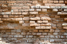 Ruins Of An Ancient Castle. Destroyed Brick Walls With Loopholes. History Of Ancient Architecture. Brick Old Background