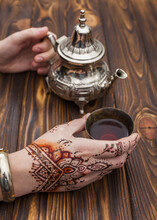 Person With Mehndi Holding Teapot Cup