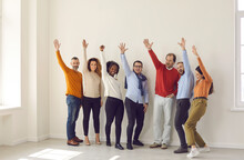 Group Of Happy Diverse Business People, Enthusiastic Coworkers, Confident Entrepreneurs, Young And Mature Managers Standing Together Hands Raised Waving Hello Or Voting. Teamwork, Team Success Concept