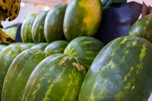 Fresh And Juicy-looking Watermelons On A Fruit Stand