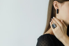 Beautiful Stylish Woman With Modern Geometric Black Ring And Earring, Space For Text. Fashionable Female In Black Dress With Unusual Fused Glass Accessory And Manicure. Beauty And Care