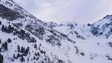 Fototapeta Kawa jest smaczna - Snowy mountain against misty sky