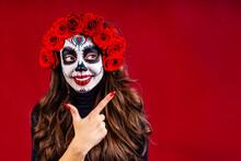 Nice Glamorous Beautiful Mexican Dark Brown Eyes Woman Ready To Santa Muerte Day Pointing At Copyspace
