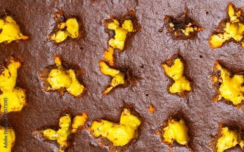 brown yellow wallpaper with cocoa sponge cake Fototapeta