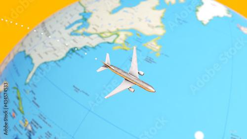 Canvas-taulu Plane Flying Around a Globe Map 3d illustration render
