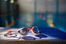 Swimming Goggles Against The Background Of A Sports Swimming Pool.