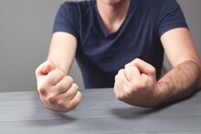 Hits The Table With His Fist