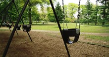 Beautiful Spring Day In Central Park. Kids Playing On Swings.