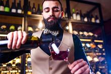 Arabian Man Sommelier Appreciating Drink In Lux Hotel