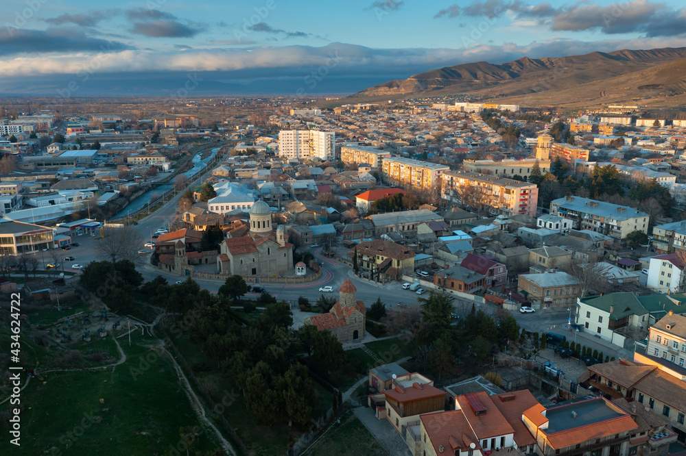 Scenic aerial view of old town of georgian city of Gori at spring