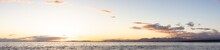 White Rock, Greater Vancouver, British Columbia, Canada. Colorful And Vibrant Panoramic View Of A Cloudy And Colorful Sunset Over The Pacific Ocean Coast. Nature Background Panorama