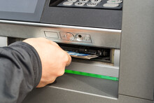 Caucasian Person Hand Receiving Banknotes From ATM Machine. Outdoor Cash Withdrawal On A Day. Bulgarian Lev Issuing By ATM On A Man Hand. Using Bank Atm. Selective Focus.