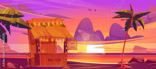 Fotografiet Tiki bar, wooden hut with tribal masks, drinks and snacks on sea beach at sunset