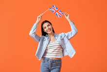 Beautiful Young Woman With The Flag Of Great Britain On Color Background