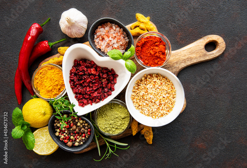 Fotografiet Dry seasonings and spices against a dark background view from the top