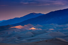 Dramatic Landscape Of Last Light Hitting The Peaks Of The Colorado Sand Dunes Under A Colorful Dusk Skies.
