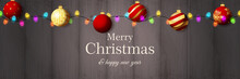Merry Christmas Banner With Red Balls On Grey Wooden Ground