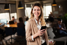 Businesswoman In Office. Smiling Businesswoman Using The Phone.