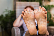 Closeup Of The Bare Dirty Feet Of A Adult Woman