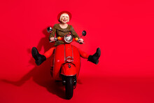 Full Size Photo Of Excited Senior Woman Happy Positive Smile Driver Motorbike Travel Speed Isolated Over Red Color Background