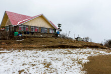 A Trekkers Hut At Tunglu Near Darjeeling With Lots Of Snow And Cloudy Sky.