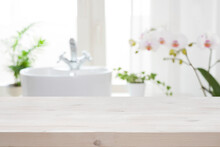 Wooden Tabletop For Product Display On Blur Bathroom Interior Background
