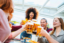 Happy Multiracial Friends Group Drinking Beer At Brewery Pub Restaurant - Friendship Concept With Young People Having Fun And Laughing Together - Focus On Black Woman