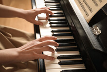 Young Woman Playing Piano, Closeup. Music Lesson