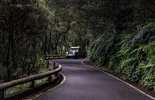4x4 Vehicle Driving Along A Winding Road From Anaga To Santa Cruz De Tenerife, Tenerife, Canary Islands, Spain