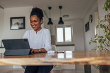 Smiling Adult Woman, Working From Home Office, Using Tablet.