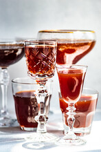 Assorted Glasses Filled With Red Wine On A Table