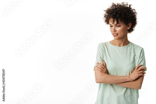 Young curly brunette woman posing and looking downward Fototapeta