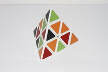 Pyraminx . Collection Of Rubik's Cube Puzzles And Other Puzzles, Geometric Shapes Of Pyramids, Disassembled Rubik's Cube . Pyramid And Rubik's Cube