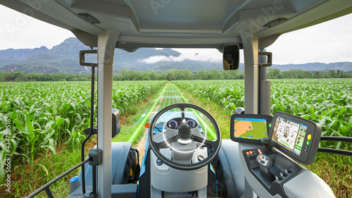 Fotografiet 5G autonomous tractor working in corn field, Future technology with smart agricu