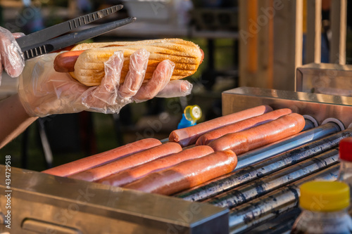 Fotografie, Tablou Sausages are fried on a rotary cooking machine