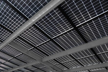 Solar Energy Panels Installed On The Canopy Of A Car Parking Area, Seen From Below. Sustainable Energy And Shade At The Same Time