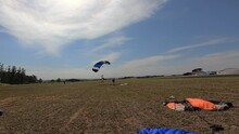 Parachutists Touching The Ground. Video 59.94 Fps