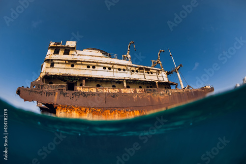 Fotografie, Obraz Old wreck ship in blue ocean in Arrecife, Lanzarote