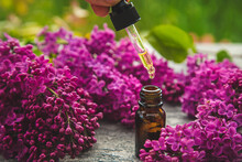 Lilac Essential Oil In A Small Bottle. Selective Focus.