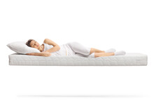 Young Woman In White Pajamas Sleeping On A Floating Mattress