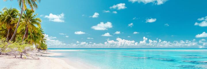 Beach paradise travel vacation tropical getaway in Rangiroa atoll, Tuamotu islands, French Polynesia. Tahiti honeymoon destination with idyllic pristine ocean crystal clear turquoise water.