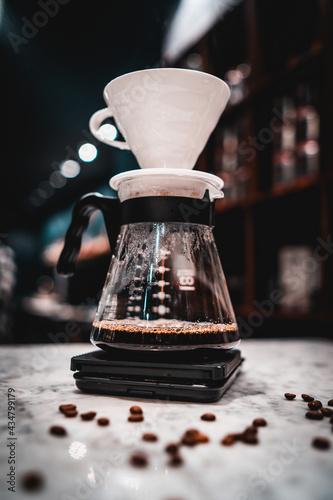 Fotografiet Close up drip coffee black coffee brewed hario style in coffee shop barista