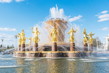 Close Up Image Of Big Beautiful Golden Fountain Friendship Of People Situated On Exhibition Of Economic Achievements In Moscow, Russia. Copy Space. Famous Touristic Place.