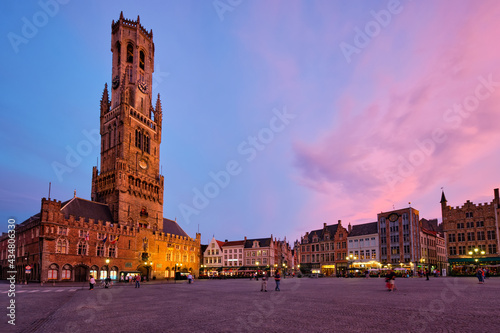 Valokuva Belfry tower and Grote markt square in Bruges, Belgium on dusk in twilight