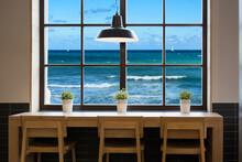 View Of Mediterranean Sea Through A Cafe Window