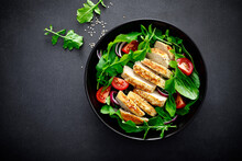 Grilled Chicken Breast And Salad. Fresh Vegetable Salad With Tomato, Arugula, Spinach And Grilled Chicken Meat In Bowl, Healthy Food, Top View.