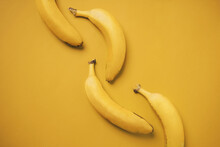 Bananas Isolated In Yellow Background