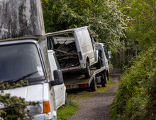Old Vehicles Dumped On A Country Path. Rotting. Derelict
